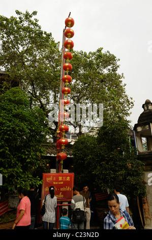 Red Chinese lanterns hanging in front of Chinese temple, Wat Mangkok Kamalawatt , Chinatown, bangkok, thailand - Stock Photo