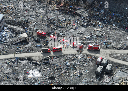 Japan (March 18, 2011) aerial view of Japanese Ground Self-Defense Force personnel and disaster relief crews searching - Stock Photo