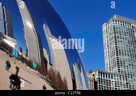 North loop skyline buildings reflection on Cloud Gate sculpture merges with a real view of the 55 E. Randolph Building - Stock Photo