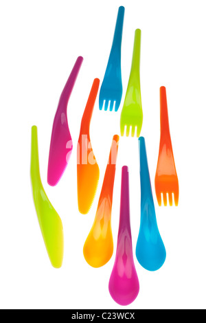 Set of three of each of brightly coloured plastic picnic knives forks and spoons - Stock Photo
