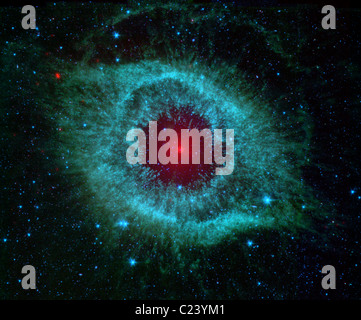 Comets Kick up Dust in Helix Nebula This infrared image from NASA's Spitzer Space Telescope shows the Helix nebula - Stock Photo