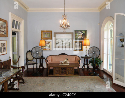 The main sitting room of the Hemingway house in Key West, Florida. - Stock Photo