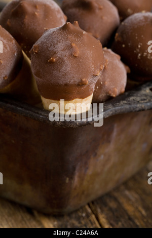 Mini ice cream cones in a tin - Stock Photo