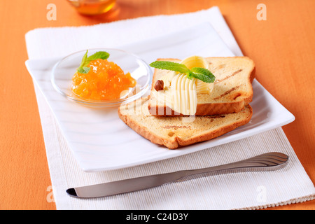Breakfast - Toasted bread, butter and marmalade - Stock Photo
