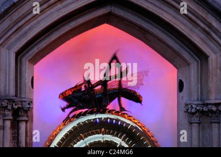 Close Up detail of The Corpus Christi Clock illuminated at dusk, Kings Parade, Cambridge, England, Uk - Stock Photo