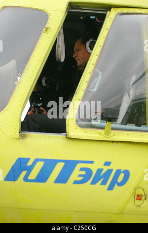 in the helicopter cockpit captain of an aircraft preparing for takeoff. Yamal peninsula, RUSSIA - Stock Photo