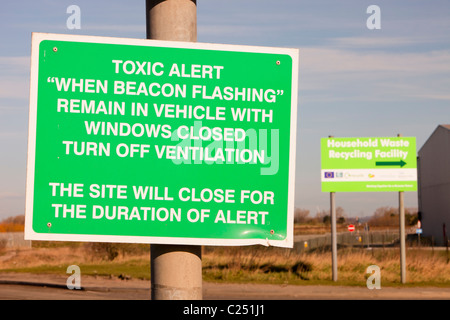 A warning sign about toxic air pollution outside a power from waste incinerator plant at Billingham on Teeside, - Stock Photo