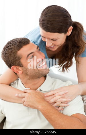Portrait of a lovely couple looking at each other while hugging - Stock Photo