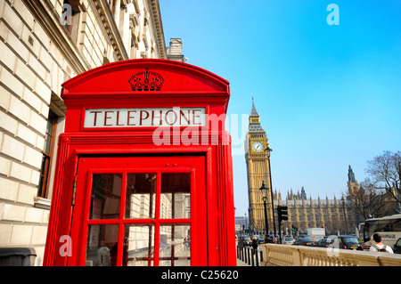 Red London Telephone box with Big Ben in background - Stock Photo