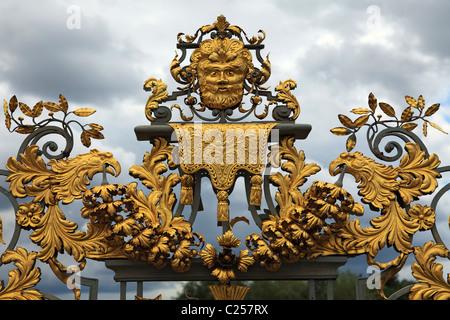 Gold Gilt gate Privy Garden at Hampton Court Palace, UK - Stock Photo