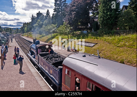 Ex. Caledonian Railway steam engine 828 standing at the platform on Boat of Garten railway station en route to Aviemore - Stock Photo