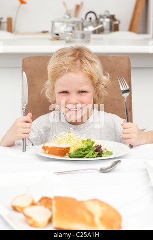 Portrait of a little boy ready to eat pasta and salad - Stock Photo