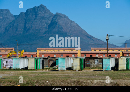 Public toilets, shacks and new housing along Vanguard Drive, Epping, Cape Town, South Africa - Stock Photo