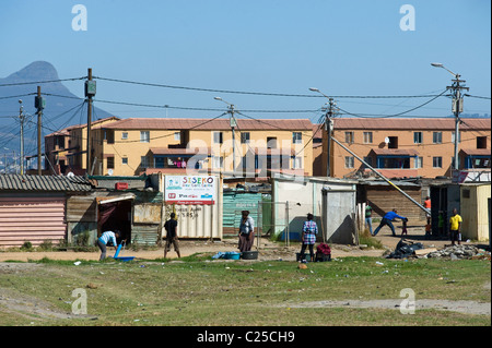 Shacks and new housing along Vanguard Drive, Epping, Cape Town, South Africa - Stock Photo