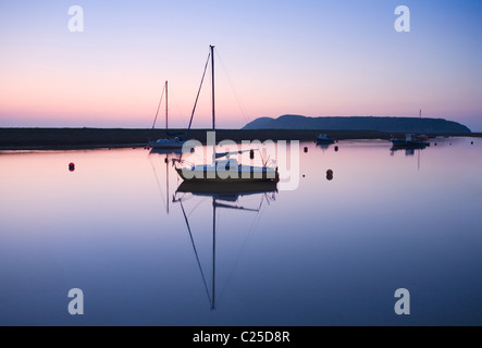 Boats Moored on the River Axe Estuary with Brean Down in the distance. Somerset. England. UK. - Stock Photo