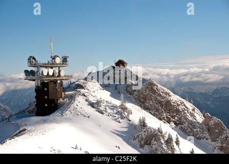 Winter Austrian Alps - telecommunication tower on top of snowy mountain - Stock Photo