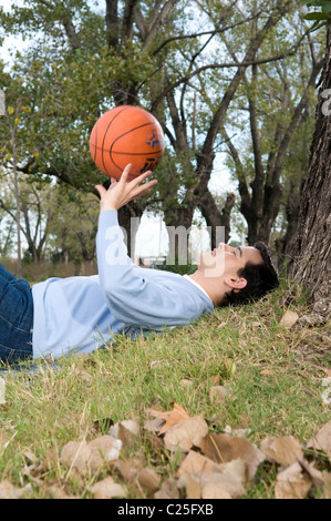 Man, Sports, campus, university, basket's, basketball's, ball, rest, play, playing, practice, practicing, park, - Stock Photo