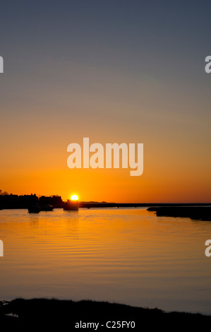 sunset at high tide in penclawdd, gower - Stock Photo