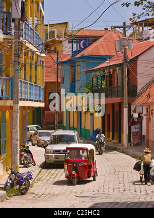 FLORES, GUATEMALA - Traffic on street in colonial village of Flores. - Stock Photo