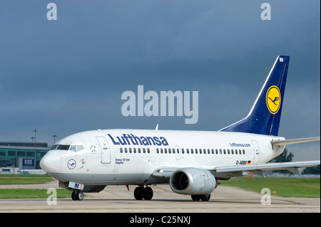 A Lufthansa aircraft prepares for take off at Manchester Airport - Stock Photo