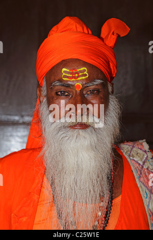 Portrait of a Hindu holy man, dressing traditional clothes, India - Stock Photo