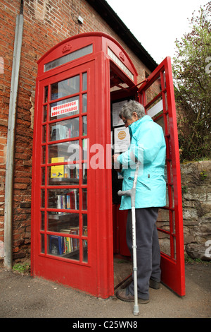 Woodborough Book Exchange in a converted telephone box in the village of Woodborough, Nottinghamshire, England, - Stock Photo