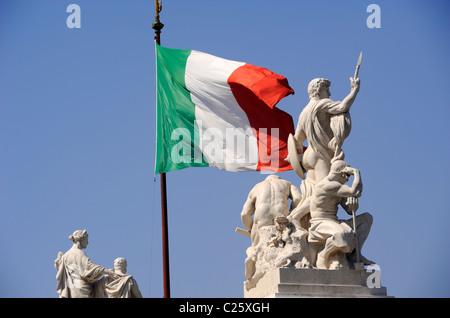 italy, rome, piazza venezia, vittoriano, statues and italian flag - Stock Photo