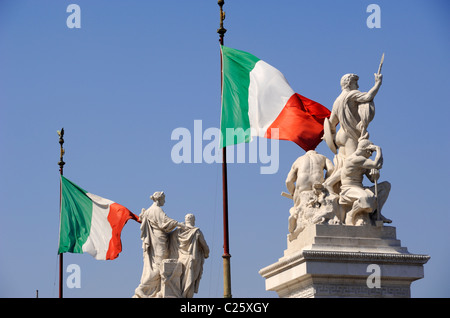 italy, rome, piazza venezia, vittoriano, statues and italian flags - Stock Photo