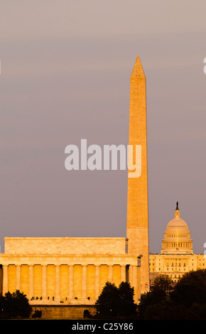 WASHINGTON DC, USA - View of famous monuments along Washington DC's National Mall lit up by the last golden rays - Stock Photo