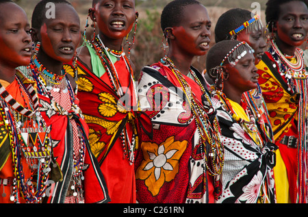 Masai women wearing traditional dress, in a village near the Masai Mara, Kenya, East Africa - Stock Photo