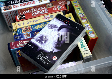 Video Tapes for sale outside a charity shop in Edinburgh, including a copy of the X-Files season 7. - Stock Photo