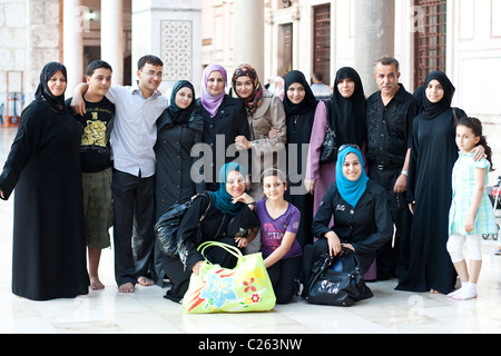 Arab family at the Umayyad Mosque, Damascus, Syria - Stock Photo