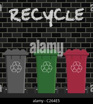 Recycling wheelie bins against a brick wall - Stock Photo