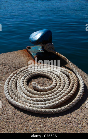 Detail view of bollard with line attached - Stock Photo