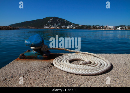 General view of bollard with line attached - Stock Photo