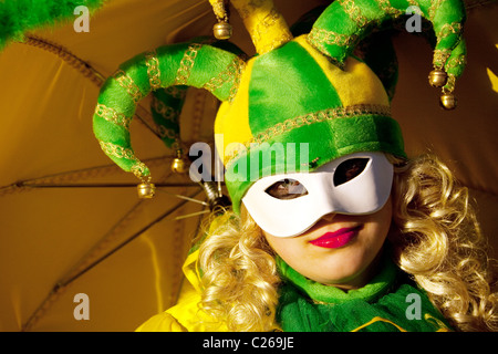 Clown in yellow and green, the Venice carnival, Venice Italy - Stock Photo