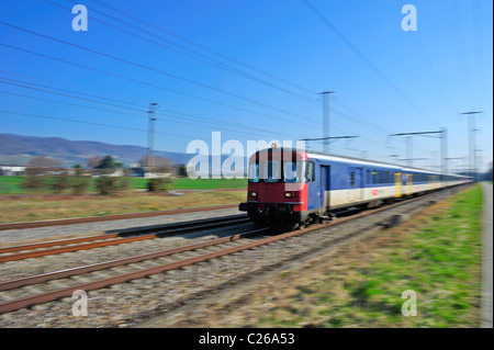 A Swiss suburban train. Motion blur used to give sense of speed. - Stock Photo