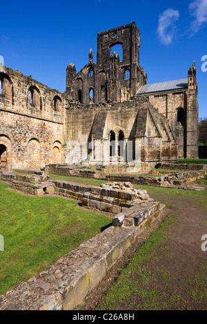 The ruins of Kirkstall Abbey a Cistercian Monastery shot in Spring sunshine Kirkstall Leeds West Yorkshire UK - Stock Photo