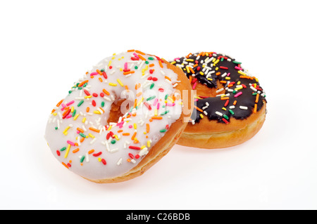 Vanilla frosted donut and chocolate frosted doughnut with colorful sprinkles on white background, cut out. - Stock Photo