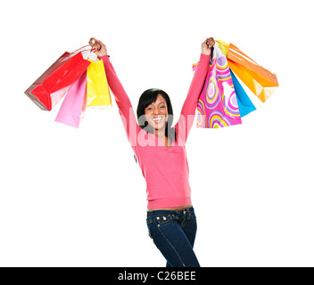 Young excited smiling black woman holding shopping bags - Stock Photo