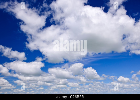 Background of blue sky with white cumulus clouds - Stock Photo
