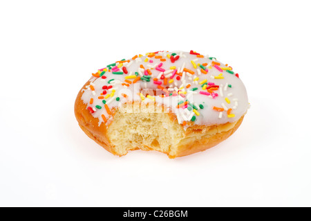 Partially eaten vanilla frosted donut with sprinkles on white background cut out - Stock Photo