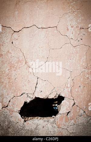 Hole in old cracked wall - Stock Photo