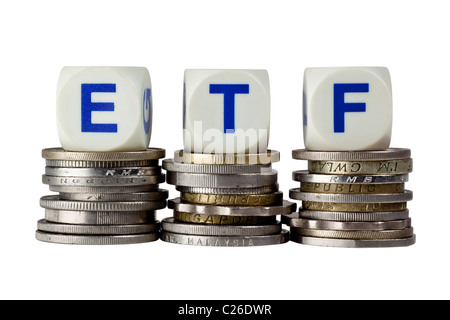 Stacks of coins with the letters ETF isolated on white background - Stock Photo