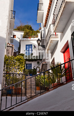 steps in the picturesque village of Frigiliana, near Nerja, Malaga Province, Andalusia, Andalucia southern Spain - Stock Photo