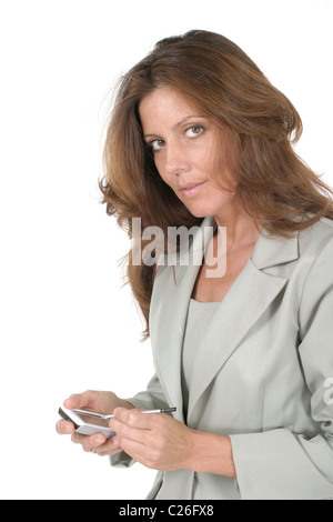 Attractive business woman using a pda, personal data assistant, handheld computing device. - Stock Photo