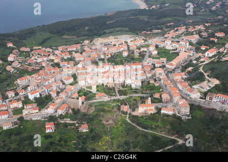 PERCHED VILLAGE OVERLOOKING THE MEDITERRANEAN SEA (aerial view). Cargèse, Corsica, France. - Stock Photo