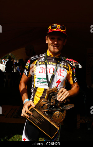 Burry Stander happy having received the trophy for the 2011 ABSA Cape Epic - Stock Photo