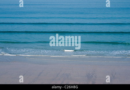 Gentle Waves on Beach at Newquay, Cornwall - Stock Photo