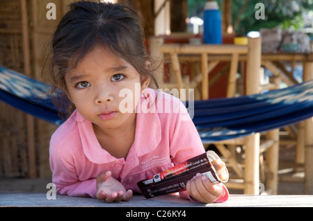 Thai child eating ice cream and leaning through the window for Tiny thai teen